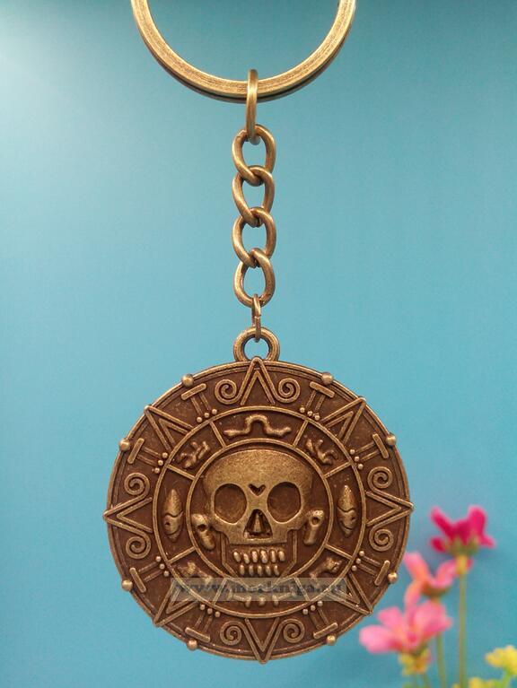 Брелок монета пиратов Карибского моря